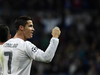 Pemain Real Madrid, Cristiano Ronaldo menjadi top skor sementara liga Champions dengan total 11 gol,  (AFP Photo/Pierre-Philippe Marcou)