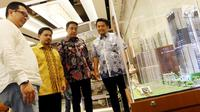 Ketum Pilars 93 Robby Budiansyah (dua kiri), Ketum KMPT Pramono Dewo (dua kanan), Project Director Grand Andika Kertajati PT PP Property Tbk Raja M.L Tobing (kanan) usai diskusi, Jakarta, Sabtu (14/9/2019). Diskusi digelar Komunitas Pengusaha Muslim Trisakti dan Pilars 93. (Liputan6.com/JohanTallo)