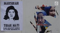 Selebaran tentang pejuang buruh Marsinah tertempel saat Buruh Internasional atau May Day di kawasan Bundaran HI, Jakarta, Rabu (1/5/2019). Buruh yang melakukan demo pada tahun ini memiliki berbagai tuntutan kepada pemerintah. (merdeka.com/Imam Buhori)