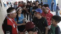 Suporter mengantre untuk menyaksikan laga final Indonesia Open di Istora Senayan, Minggu, (8/7/2018). (Bola.com/M Iqbal Ichsan)