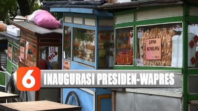 Panitia telah memasang tulisan laik konsumsi di tiap gerobaknya. Para pedagang nasi goreng ini sengaja didatangkan panitia inagurasi presiden dan wakil presiden 2019-2024.