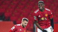 Reaksi pemain Manchester United Paul Pogba saat laga melawan Sheffield United pada pertandingan Liga Inggris di Old Trafford, Manchester, Inggris, Rabu (27/1/2021). Sheffield United menang 2-1. (AP Photo/Tim Keeton,Pool)