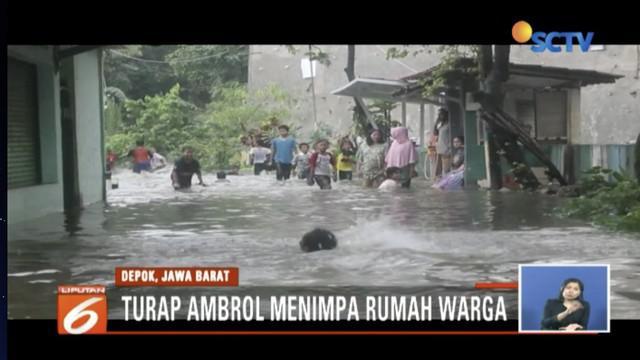 Tebing pembatas luster Taman Cimanggis ambrol, pemukiman warga di Perumahan Tirta Mandala, Cilodong, Depok, tergenang air.