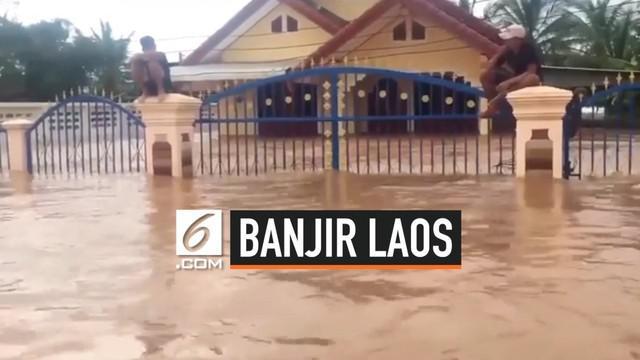 Banjir melanda wilayah selatan negara Laos dan menewaskan 14 warga. Banjir dipicu hujan deras yanng diakibatkan badai tropis Podul.
