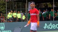 Indonesia lolos dari lubang jarum setelah mereka menang 3-1 atas Kuwait Piala Davis Grup II Zona Asia/Oseania, di Lapangan Tenis Manahan, Solo, Minggu (9/4/2017). (Bola.com/Ronald Seger)