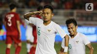 Gelandang Timnas Indonesia U-22, Sani Rizki, merayakan gol yang dicetaknya ke gawang Vietnam U-22 pada laga SEA Games 2019 di Stadion Rizal Memorial, Manila, Filipina, Minggu (1/12/2019). Indonesia kalah 1-2 dari Vietnam. (Bola.com/M Iqbal Ichsan)