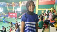 Atlet putri dari Aceh Barat, Dian Ramadhani Mukti harus rela terhenti di fase turnamen Audisi Umum Beasiswa Bulu Tangkis karena kelelahan (Liputan6.com/Defri Saefullah)