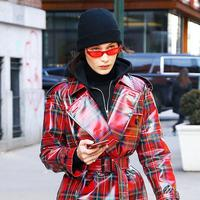 Bella Hadid in Poppy Lissiman's Le Skinny Sunglasses - Photo: whowhatwear