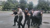 Tim khusus pengawal paslon kepala daerah di Sulsel (Liputan6.com/ Eka Hakim)