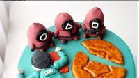 Squid Game Dijadikan Tema Kue Ulang Tahun, Bentuk Penjaganya Jadi Sootan. (dok.Instagram @bidibi.jkt/https://www.instagram.com/p/CUwRDcABsv0/Henry)