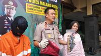 Pelaku persetubuhan anak di bawah umur digelandang ke Polres Malang Kota (Zainul Arifin/Liputan6.com)
