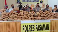 Kepolisian resor Pasaman menangkap dua tersangka yang membawa narkoba dari Sumatera Utara. (Liputan6.com/ Dok Polres Pasaman).