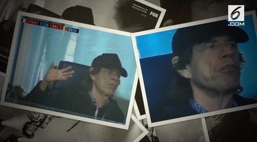 Penyanyi asal Inggris Mick Jagger tertangkap kamera asyik menonton pertandingan antar Prancis dan Belgia.