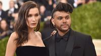 Hal ini juga dikatakan oleh seorang sumber, saat ini The Weeknd terus berusaha cari cara untuk mendekati Bella. The Weeknd terus bertanya dengan teman-teman dekat Bella soal keberadaannya. (AFP/Dimitrios Kambouris)