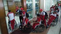 Rombongan besar kontingen Indonesia di Asian Para Games 2018 bertolak ke Jakarta, Minggu (30/9/2018). (Bola.com/Ronald Seger)
