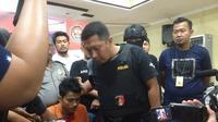 Zulkifli, anggota komplotan pembunuh sadis satu keluarga di Makassar akhir tertangkap (Liputan6.com/ Eka Hakim)