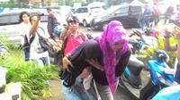 Penculik Salwa dan Salma saat digiring ke ruang penyidikan (Liputan6.com/Achmad Sudarno)