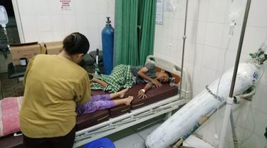 Puluhahn warga di Bogor keracunan usai menyantap tutut atau keong sawah (Liputan6.com/Achamd Sudarno)