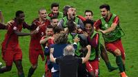 Para pemain Portugal merayakan gol Eder ke gawang Prancis pada final Piala Eropa 2016 di Stade de France, Saint-Denis, Minggu (10/7/2016). (AFP/Miguel Medina)