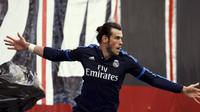 Gareth Bale mencetak dua gol saat Real Madrid menundukkan Rayo Vallecano 3-2 dalam laga La Liga Spanyol di Stadion Campo de Fútbol de Vallecas, Sabtu (23/4/2016). (Reuters/Sergio Perez)