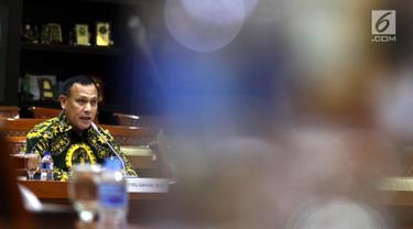 Calon Pimpinan KPK Irjen Pol Firli Bahuri menjalani uji kepatutan dan kelayakan di ruang rapat Komisi III DPR RI, Senayan, Jakarta, Kamis (12/9/2019). Para capim KPK mempresentasikan makalah dengan tema yang ditentukan saat uji kelayakan dan kepatutan. (Liputan6.com/Johan Tallo)