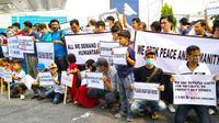 Pencari suaka di Pekanbaru mendemo kantor perwakilan IOM dan UNHCR berharap dapat kepastian. (Liputan6.com/M Syukur)