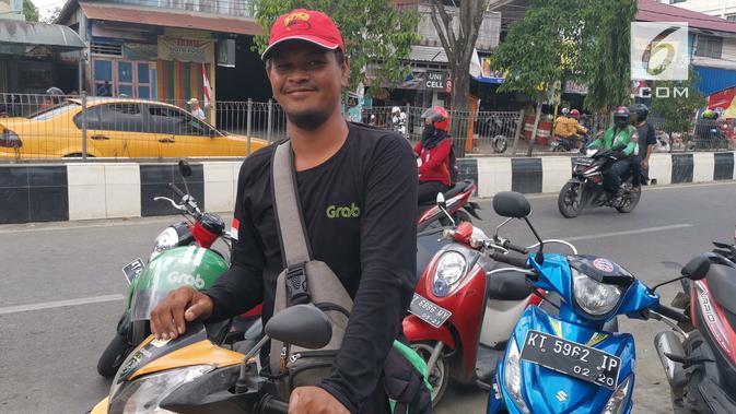 Bambang Indrayanto, mitra driver Grab Bike saat ditemui di Samarinda, Kalimantan Timur. (Liputan6.com/ Andina Librianty)