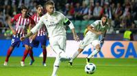Sergio Ramos mencetak gol melalui tendangan penalti. (doc. UEFA)