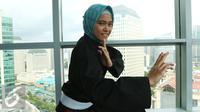 Atlet pencak silat wanita, Puspa Arumsari saat menjadi bintang tamu di Corner6, Liputan6.com di SCTV Tower, Jakarta, Rabu (18/1). (Liputan6.com/Fatkhur Rozaq)