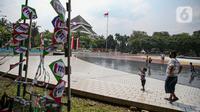 Wisatawan saat mengunjungi TMII, Jakarta, Kamis (20/8/2020). Libur panjang yang bertepatan tahun baru islam di manfaatkan masyarakat bersama keluarga  berlibur ke sejumlah tempat wisata. (Liputan6.com/Faizal Fanani)