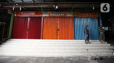 FOTO: PPKM Darurat, Kawasan Pasar Tanah Abang Dijaga Ketat Satpol PP
