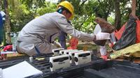 Batan mengumpulkan 638 drum berisi tanah terkontaminasi Cesium 137 di perumahan Batan Indah. (Liputan6.com/Pramita Tristiawati)