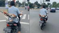 Ayam bonceng motor (Sumber: Twitter/Pidutski1)