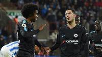 Carles Puyol memperingatkan barisan lini pertahanan Barcelona untuk mewaspadai pergerakan Willian, Eden Hazard, dan Pedro pada leg 2 babak 16 besar Liga Champions 2017-2018 di Camp Nou. (AFP/Oli Scarff)