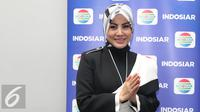 Aktris Cici Paramida berpose usai jumpa pres program spesial ramadan di Indosiar, Jakarta, Jumat (20/05/2016). (Liputan6.com/Herman Zakharia)
