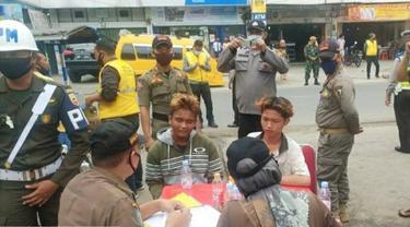 Razia protokol kesehatan untuk menekan penyebaran Covid-19 di Pekanbaru.