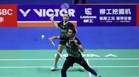 Aksi Tontowi Ahmad/Winny Oktavina Kandow pada perempat final China Terbuka 2019 di Olympic Sports Center, Jumat (20/9/2019). (PBSI)