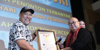Film Warkop DKI Reborn tercatat dalam Museum Rekor Indonesia (MURI). Tidak tanggung-tanggung, film itu mendapatkan dua rekor sekaligus. Sebagai Penonton Terbanyak dan Jumlah Penonton Tercepat. (Adrian Putra/Bintang.com)