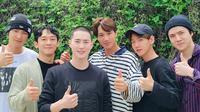 EXO melepas Suho wamil. (SM Entertainment via Soompi)
