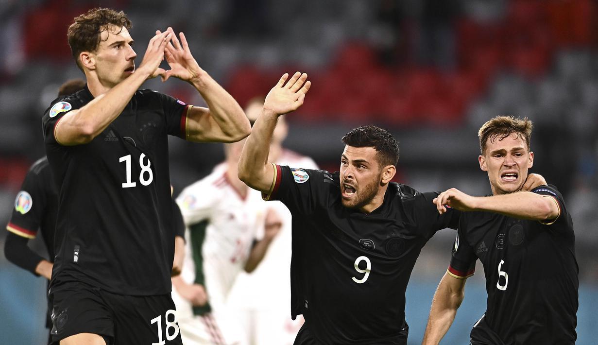 Timnas Jerman memastikan satu tempat di babak 16 besar Euro 2020 dengan dramatis. Mereka menduduki posisi kedua dalam Grup F usai bermain imbang 2-2 melawan Hungaria. (Foto: AP/Pool/Lukas Barth)