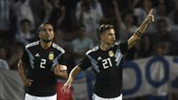 Selebrasi Paolo Dybala usai mencetak gol kedua timnas Argentina ke gawang Meksiko Meksiko pada laga persahabatan yang berlangsung di stadion Malvinas, Rabu (21/11). Argentina menang 2-0 atas Meksiko (AFP/Andres Larrovere)
