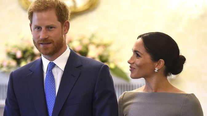 Meghan Markle dan Pangeran Harry (AP Photo)