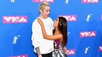 Ditanya mengenai ciuman pertama, Ariana Grande pun mengatakan hal menggemaskan mengenai momen itu. (Nicholas Hunt  GETTY IMAGES NORTH AMERICA  AFP)