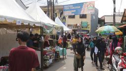 Suasana Festival Tugu Pancoran di Jakarta, Minggu (1/12/2019). Di festival ini diadakan senam, bazar, panggung hiburan, pentas seni budaya, lomba qosidah, lomba mewarnai dan lomba tarian daerah. (Liputan6.com/Herman Zakharia)