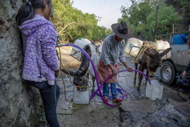 Kekurangan air di Santa Cruz Acalpixca, Meksiko. Foto: CLAUDIO CRUZ / AFP