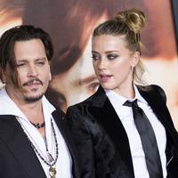 Perceraian Johnny Depp dan Amber Heard memang sudah selesai satu setengah tahun yang lalu. (VALERIE MACON / AFP)