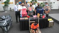 Polisi di Surabaya menangkap pelaku jambet ibu dan anak. Polisi juga menindak tegas pelaku dengan memberikan timah panas. (Foto: Dok Istimewa)