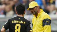 Ilkay Gundogan pernah ditangani Jurgen Klopp ketika masih membela Borussia Dortmund. (doc. Borussia Dortmund)