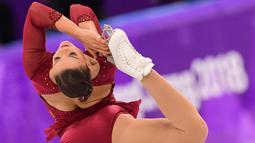 Penampilan Alexia Paganini dari Swiss saat menari dalam kejuaraan figure skating wanita gaya bebas pada Olimpiade Musim Dingin Pyeongchang 2018 di Gangneung Ice Arena di Gangneung (23/2). (Roberto Schmidt)