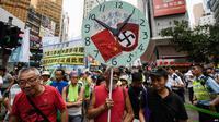 Para aktivis pro-demokrasi Hong Kong melakukan aksi unjuk rasa untuk memrotes kebijakan Beijing yang dianggap represif, 1 Oktober 2018 lalu (AFP)